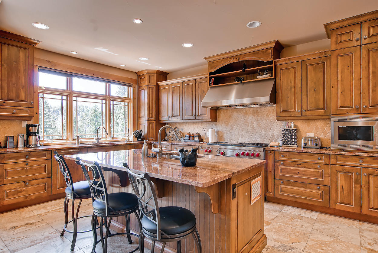 With two undermount sinks, high end Wolf appliances, and a Sub-zero fridge, this kitchen would please even Julia Child herself.