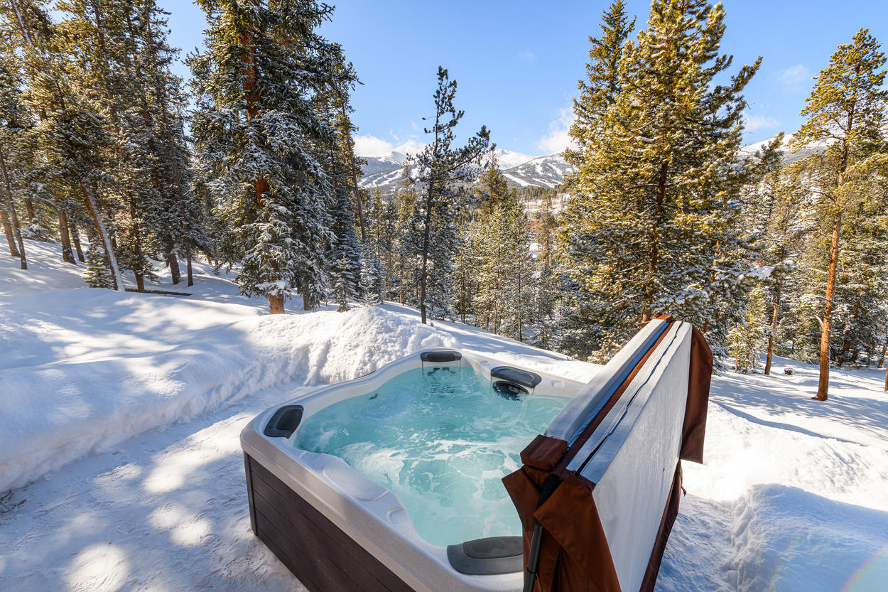 Perched on the hillside, the private hot tub offers plenty of privacy
