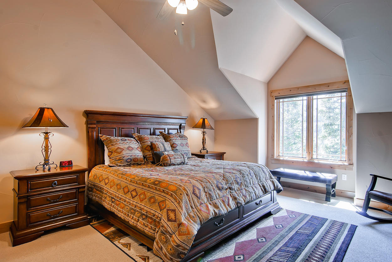 On the top level, the Guest Bedroom 2 has a king bed, TV, private bath, and cathedral ceilings.