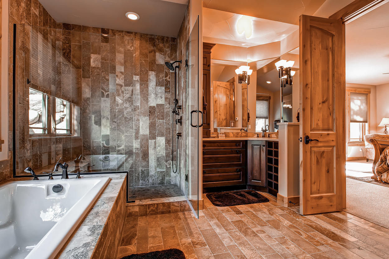 The luxurious Master Bedroom ensuite includes a jetted tub, separate shower, and double vanity.