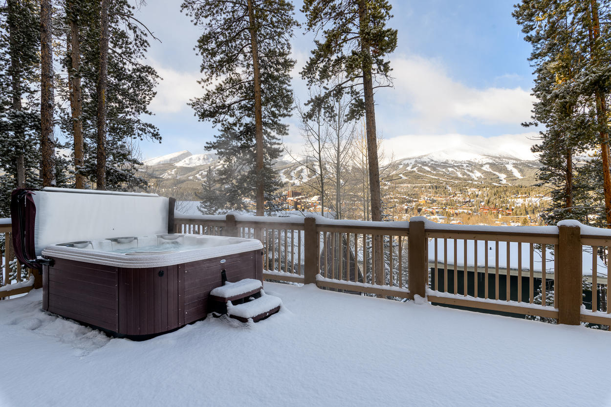 On the deck, the private hot tub comfortably seats up to 8