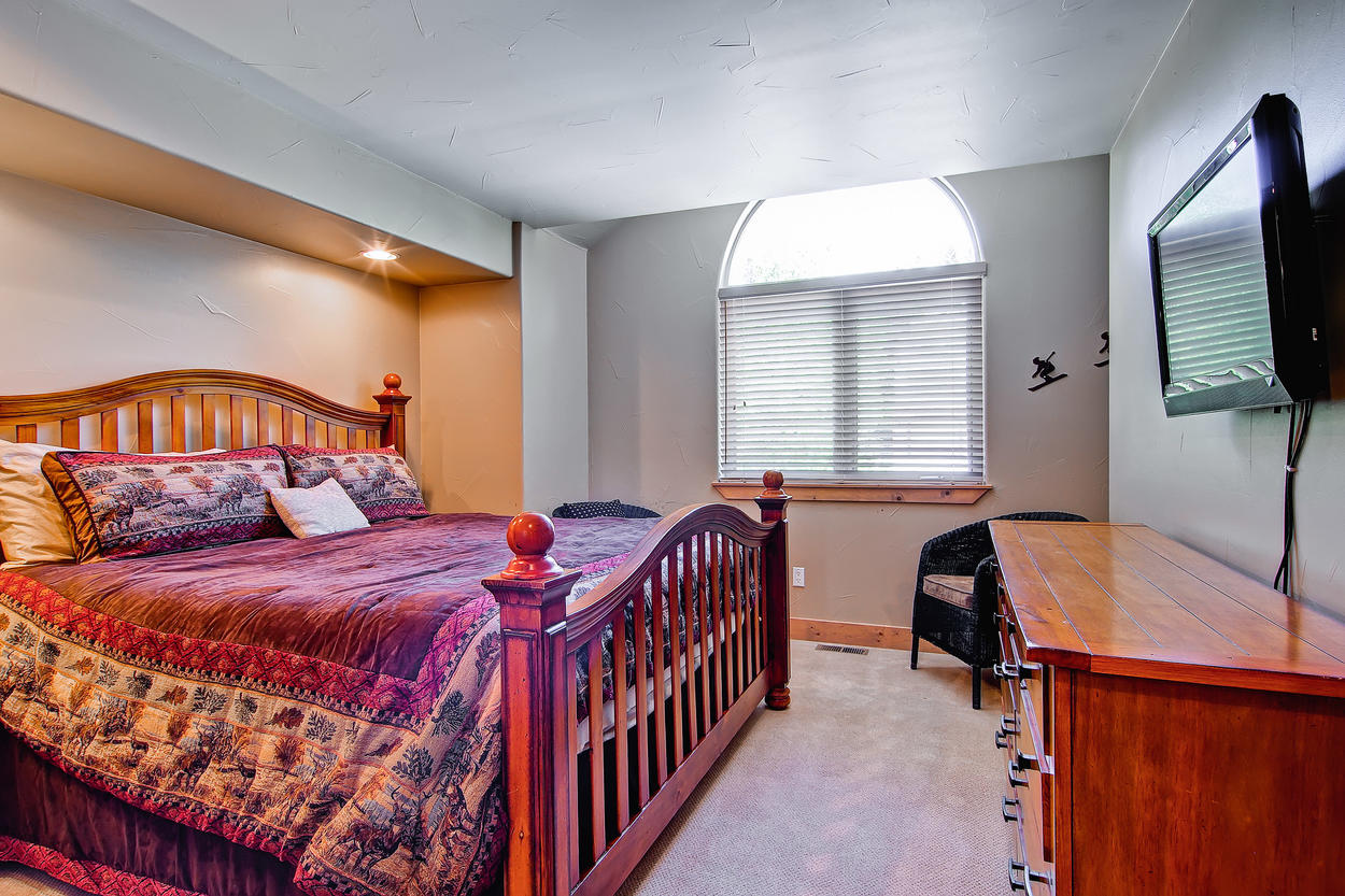 This top floor Guest Bedroom 3 features a king bed, T.V., and ensuite bathroom with a shower/tub combo.