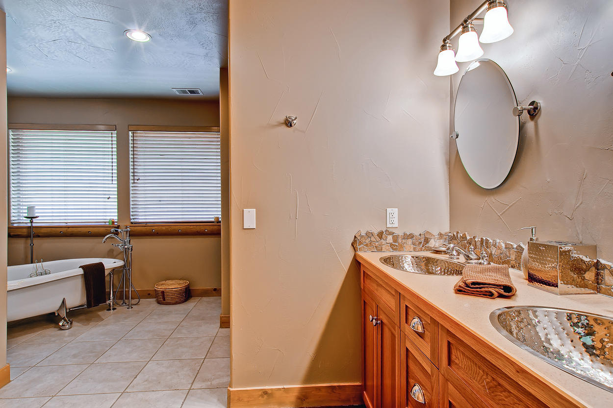 Master bathroom features a large soaking tub, walk-in shower and walk-in closet.