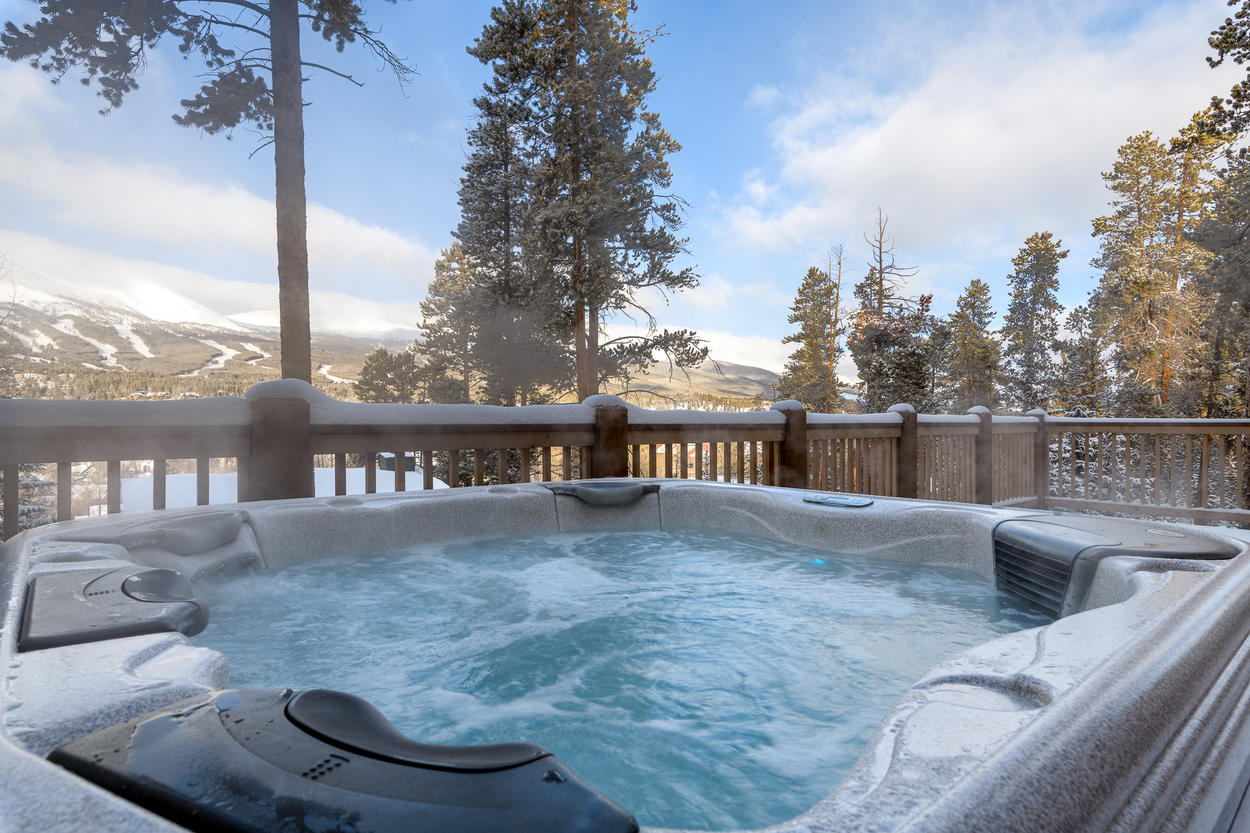 The private outdoor hot tub on the deck offers a relaxing spot to soak as well as sweeping views of the runs at Breckenridge ski resort