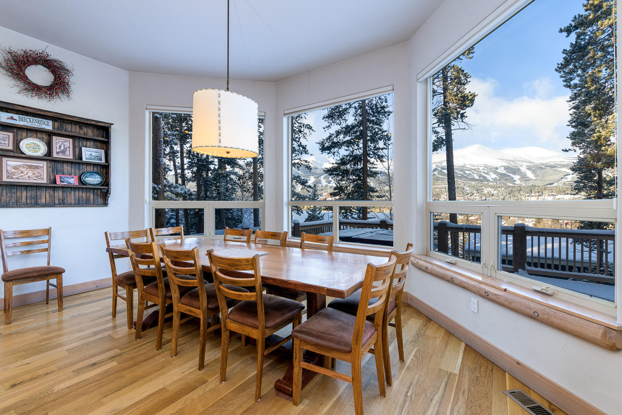 This dining table for 12 also features vast windows and a view of the mountains.