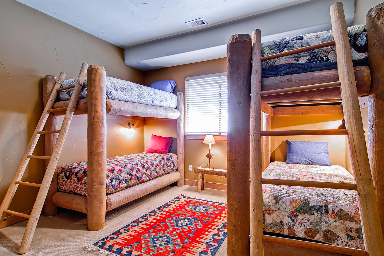 Guest bedroom 4 is great for the kiddos! 2 sets of twin bunks along with a T.V. On the lower level of the home.