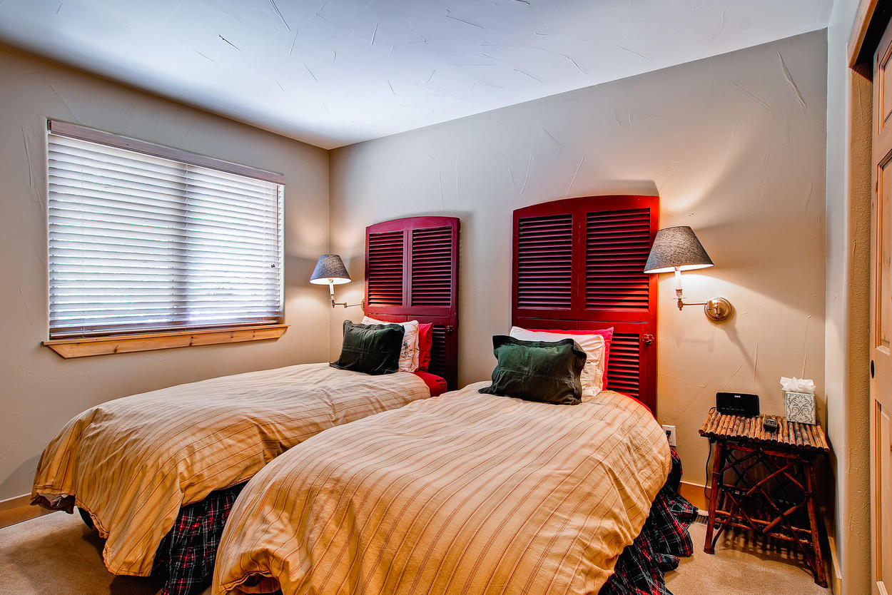 Guest bedroom 2, on the top floor, features 2 twin beds, T.V. and easy access to the hallway bathroom.
