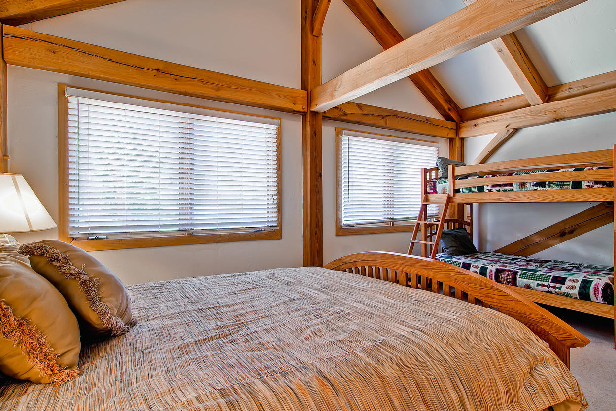 The upstairs Junior Master Bedroom has a queen-size bed and twin bunks, TV, and private bath.
