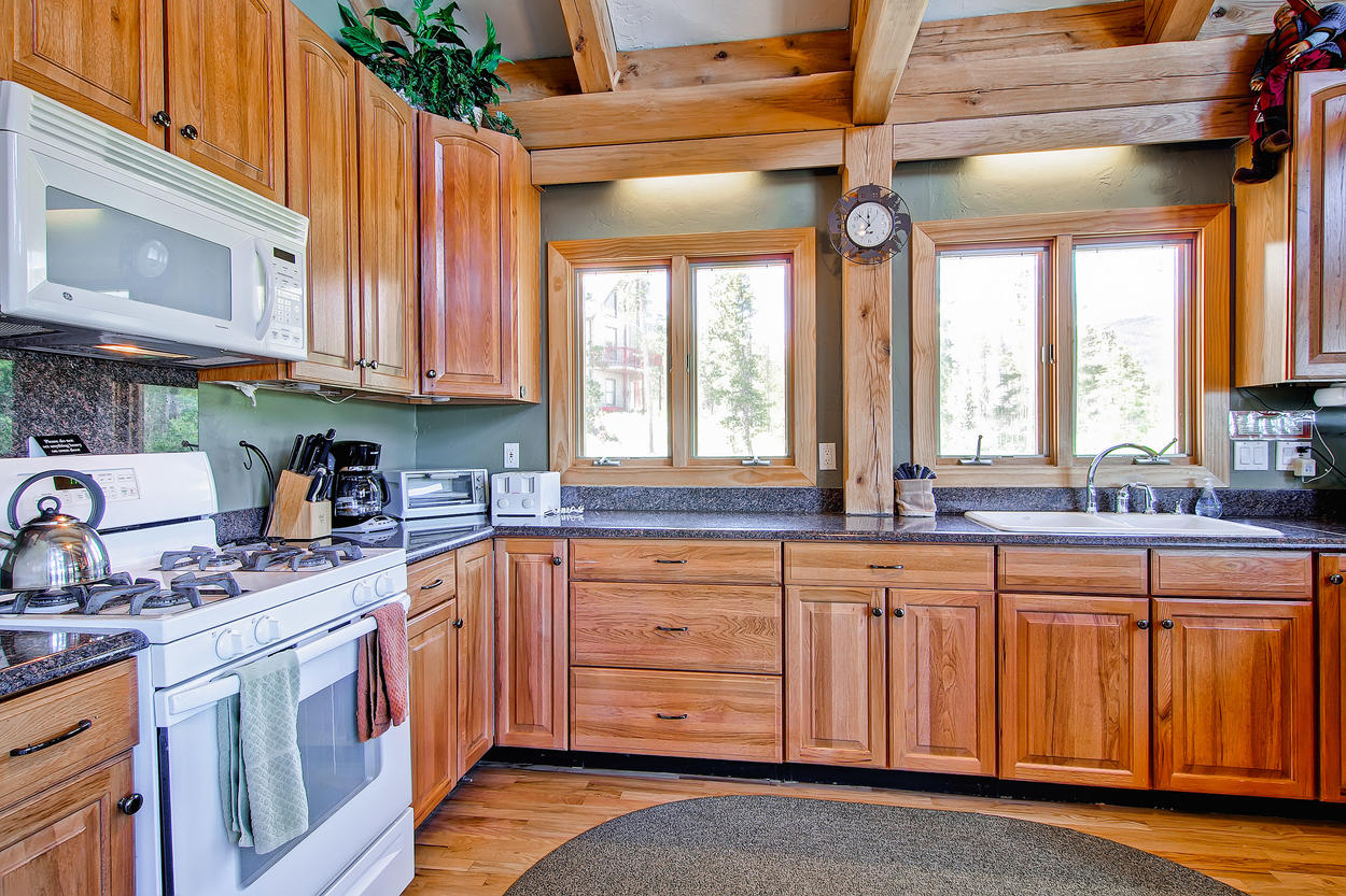 The kitchen has since been updated with stainless steel appliances.