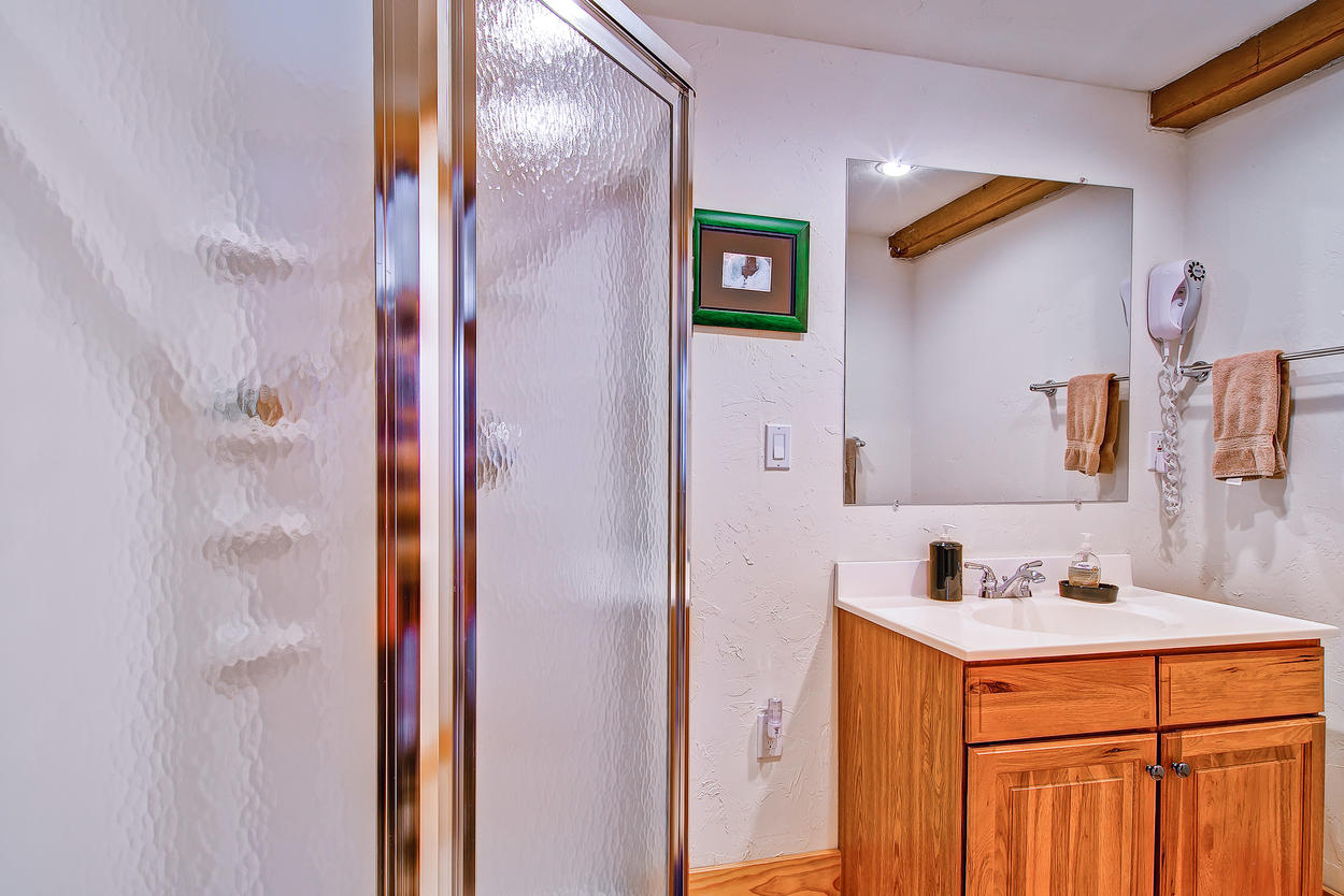 The private bath for the Junior Master Bedroom has a walk-in shower and single vanity.