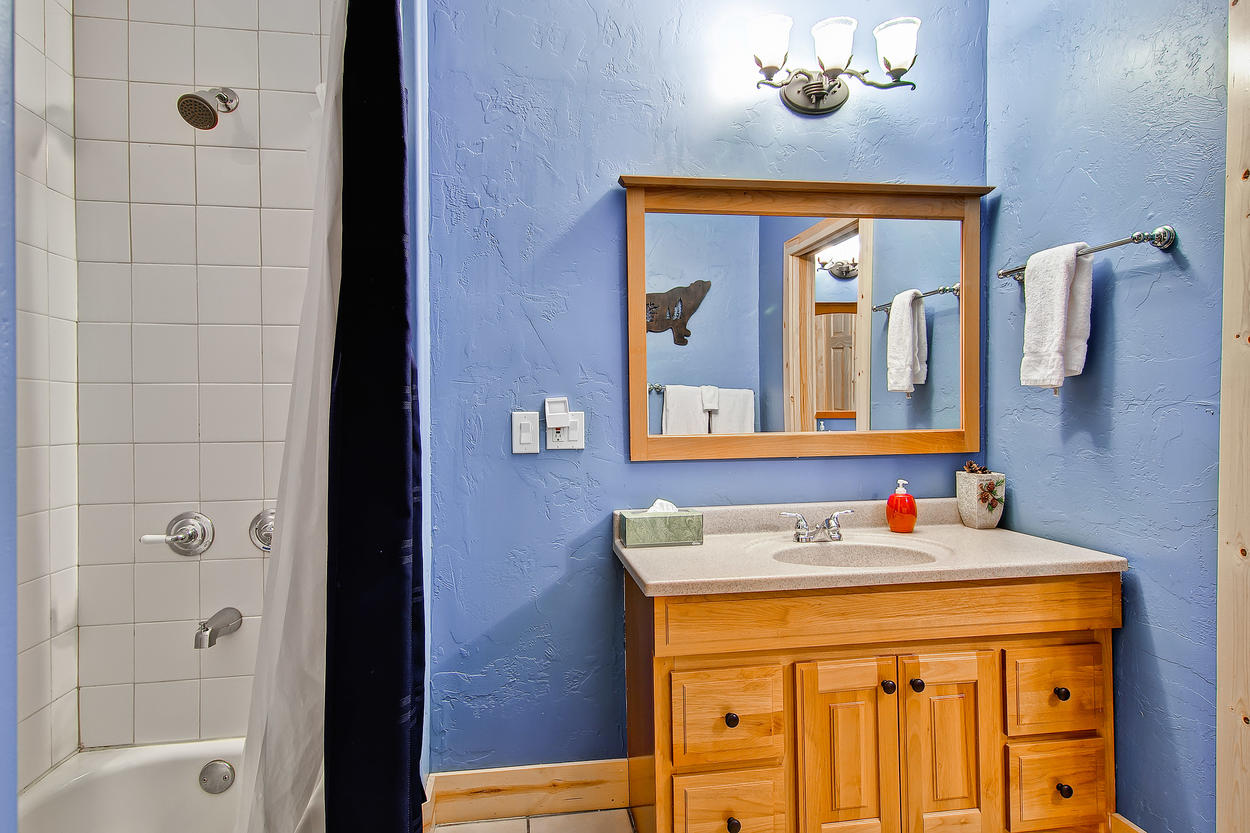 The downstairs shared bathroom has a tub/shower combo and single vanity.