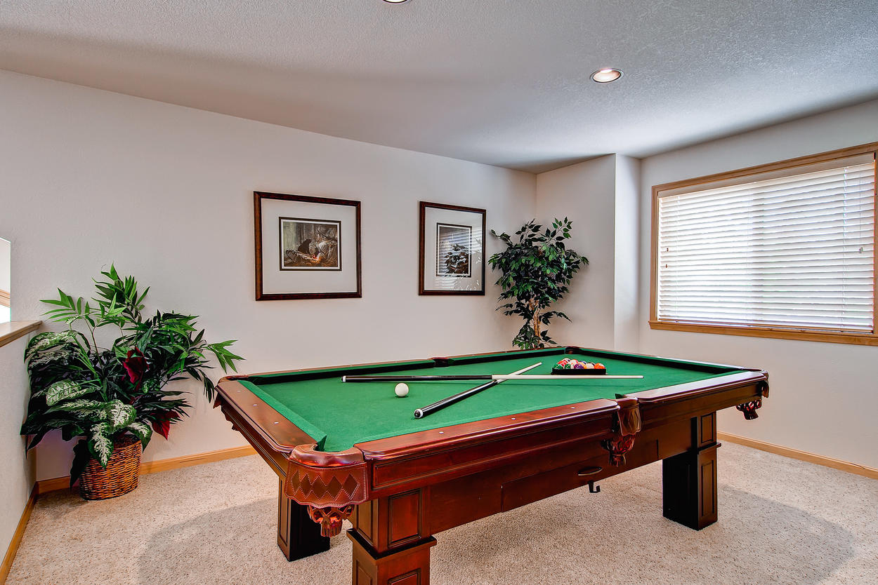 The open loft is a perfect place to enjoy a game of pool, just don't hit it too hard. You'll whack someone downstairs!