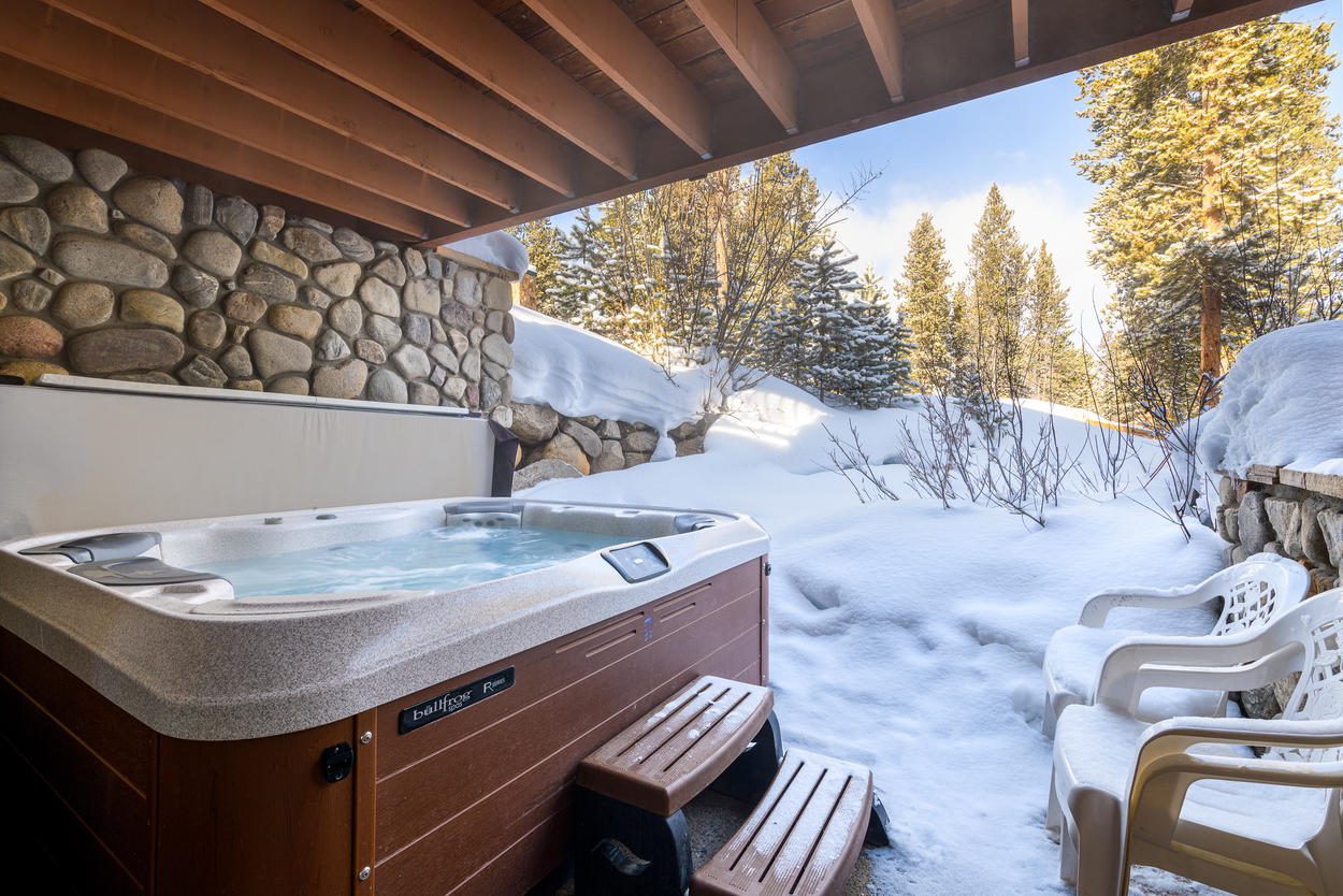 The private hot tub is located just outside from the lower level rec room and offers plenty of privacy