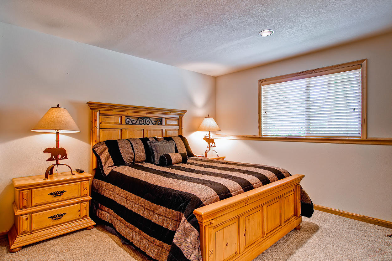 Lower level bedroom, features queen bed and TV. Rollaway bed stored in the closet.