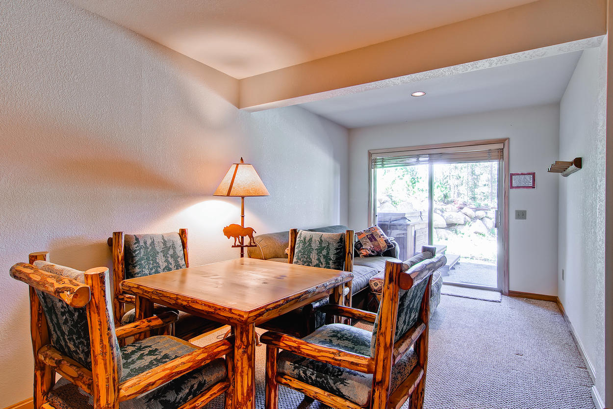 The downstairs table is a great place to play cards. This area also has a queen sleeper sofa and rollaway twin in the closet.