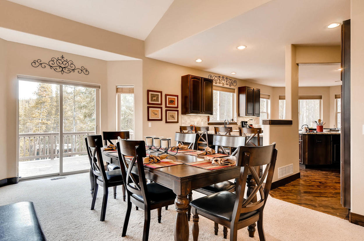 Enjoy the view while dining with your family at this 6 person table. There is also a 6 person table in the kitchen, 4 stools at the bar, and 2 stools at the kitchen island.