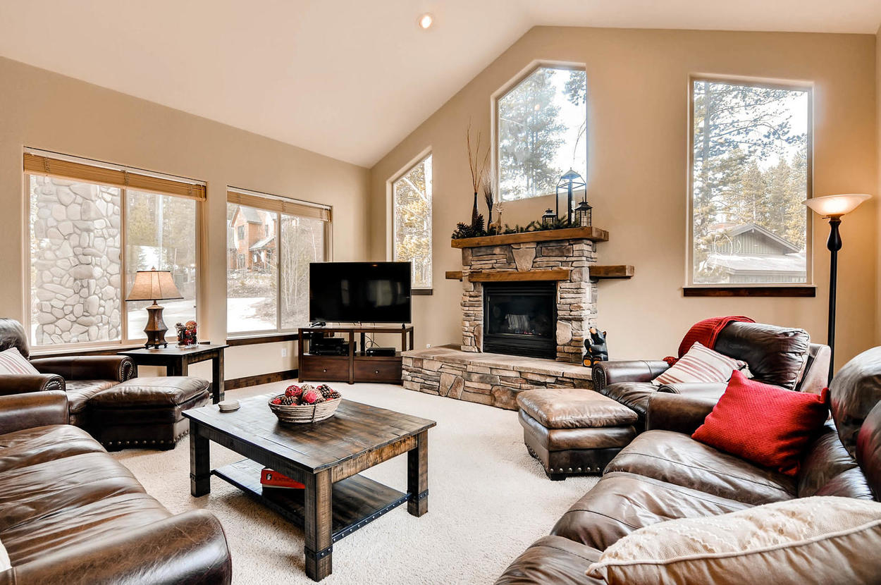 Take in the view in the main family room. Features large gas fireplace and TV.