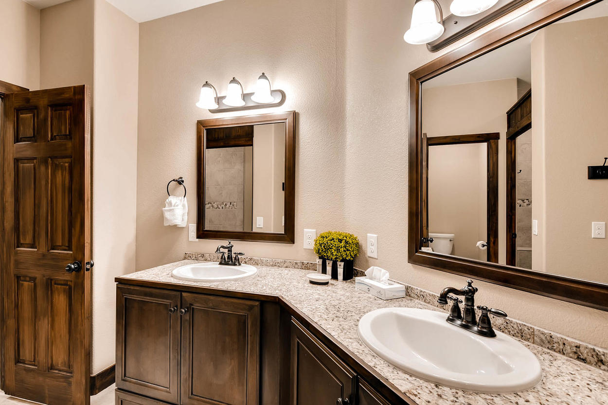This downstairs hallway bathroom is located directly across from guest bedrooms 6 and 7. Features a walk-in shower and very convenient open-floor double vanity.
