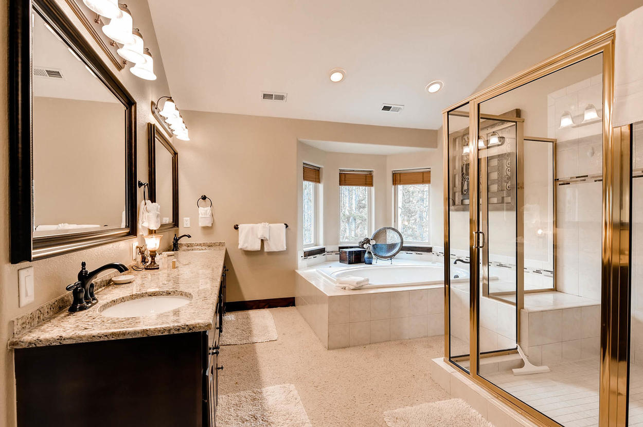 Features a large soaking tub, two vanities and walk-in shower