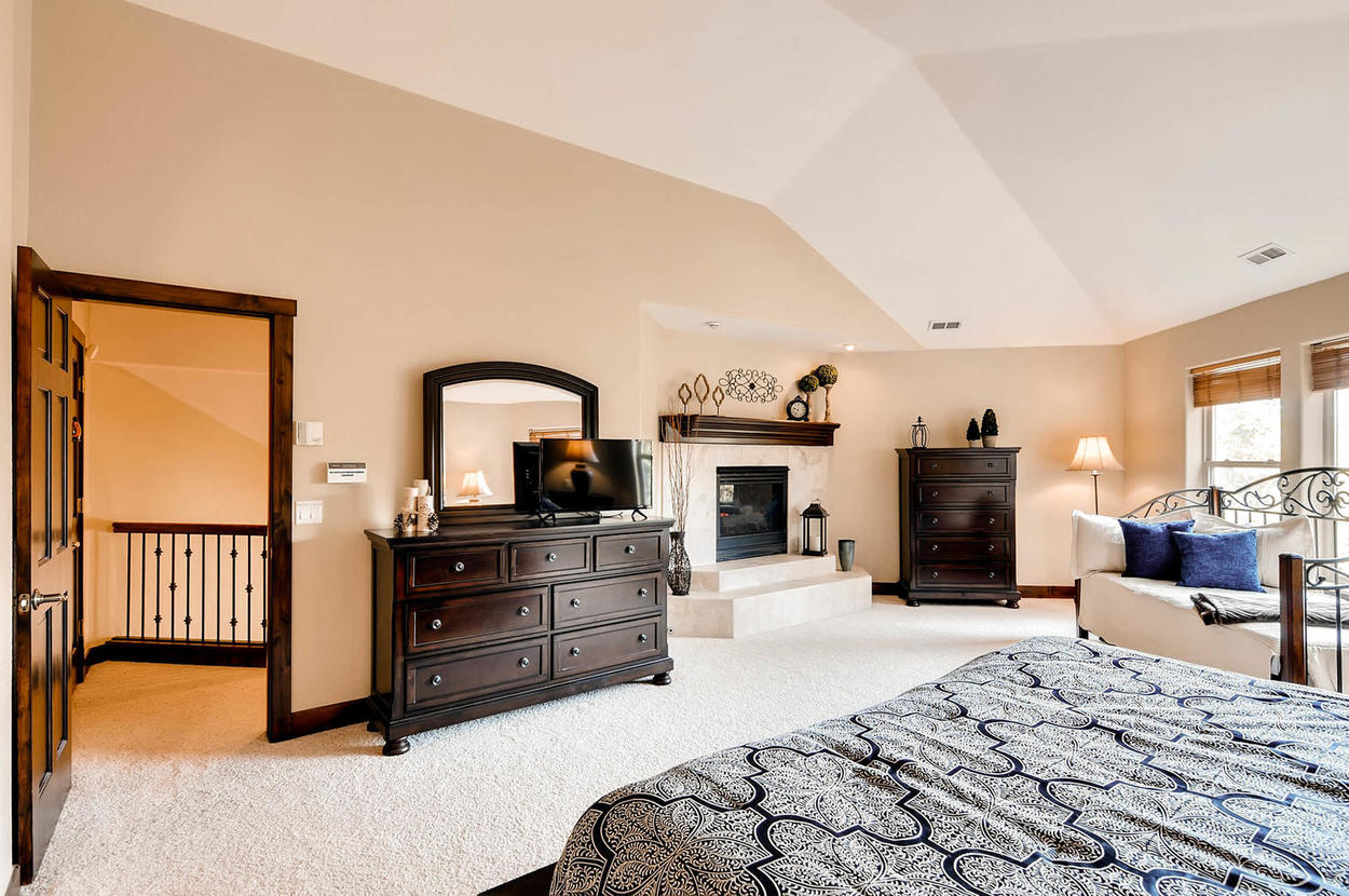 master suite features a king bed, twin trundle, fireplace, TV, large ensuite bathroom and walk in closet.