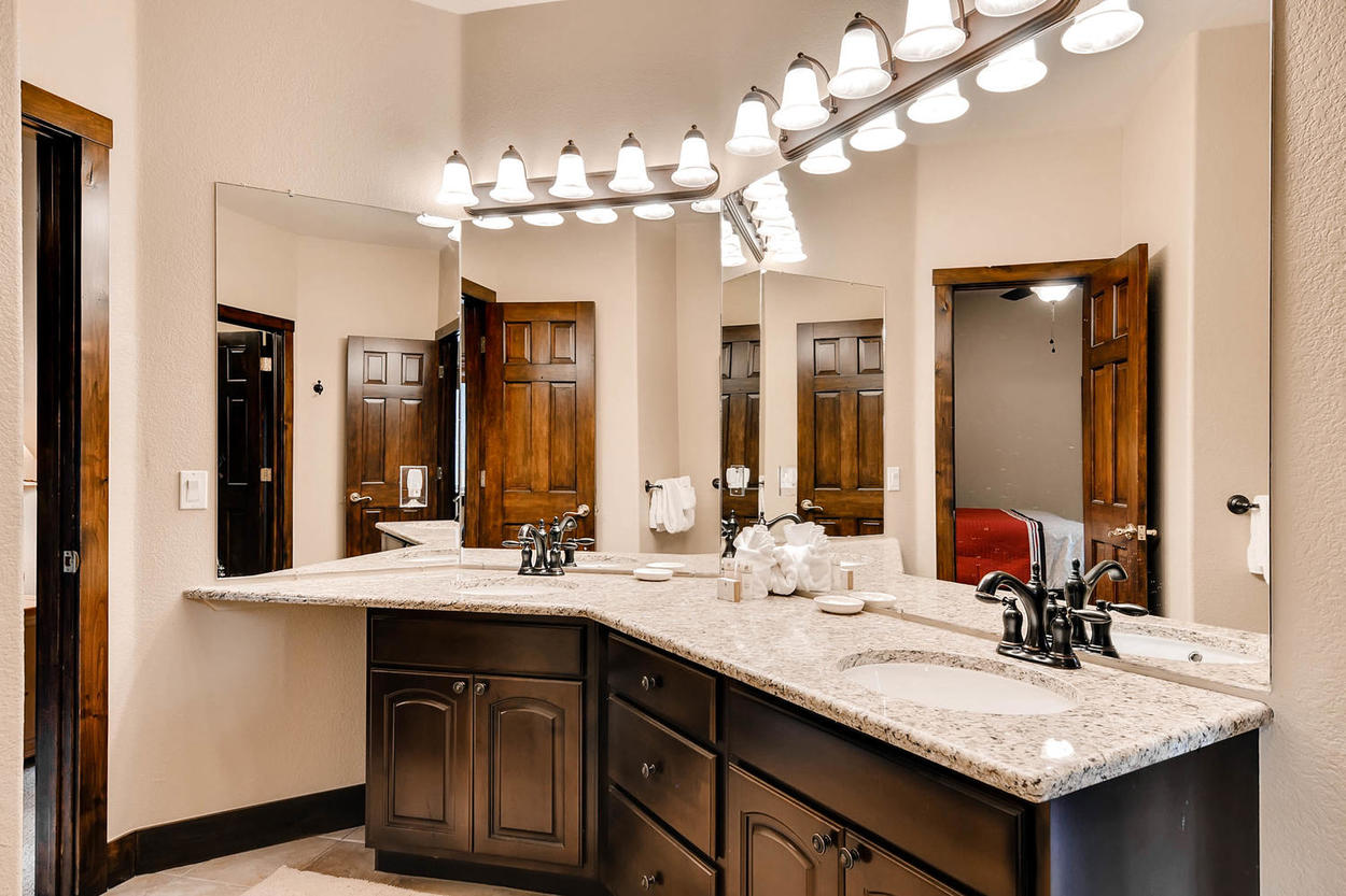 Jack and jill shared by guest bedroom 2 and 3. Includes a double vanity, and walk-in shower