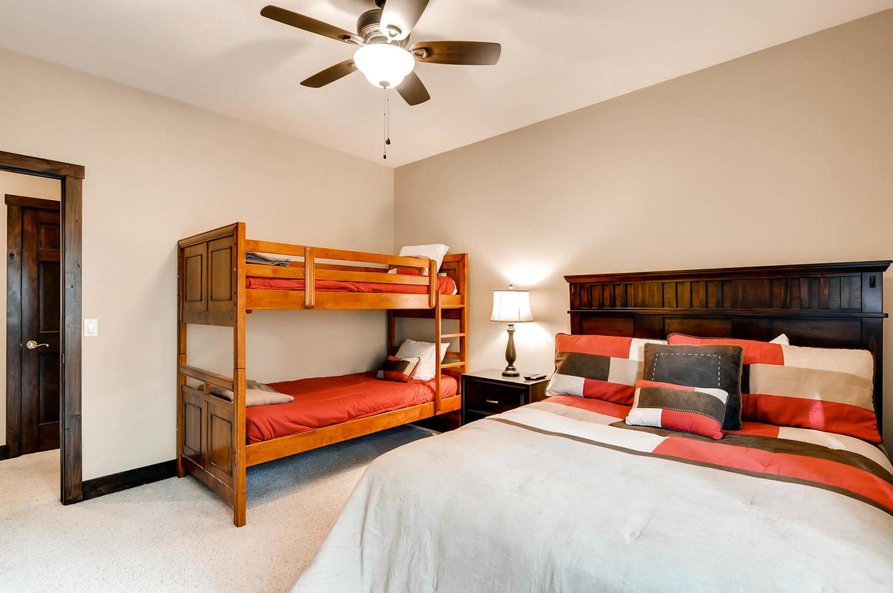 On the main floor, guest bedroom 3 is great for the kids. It features a queen bed, twin bunk bed, TV, and shares the jack and jill bathroom with guest bedroom 2.