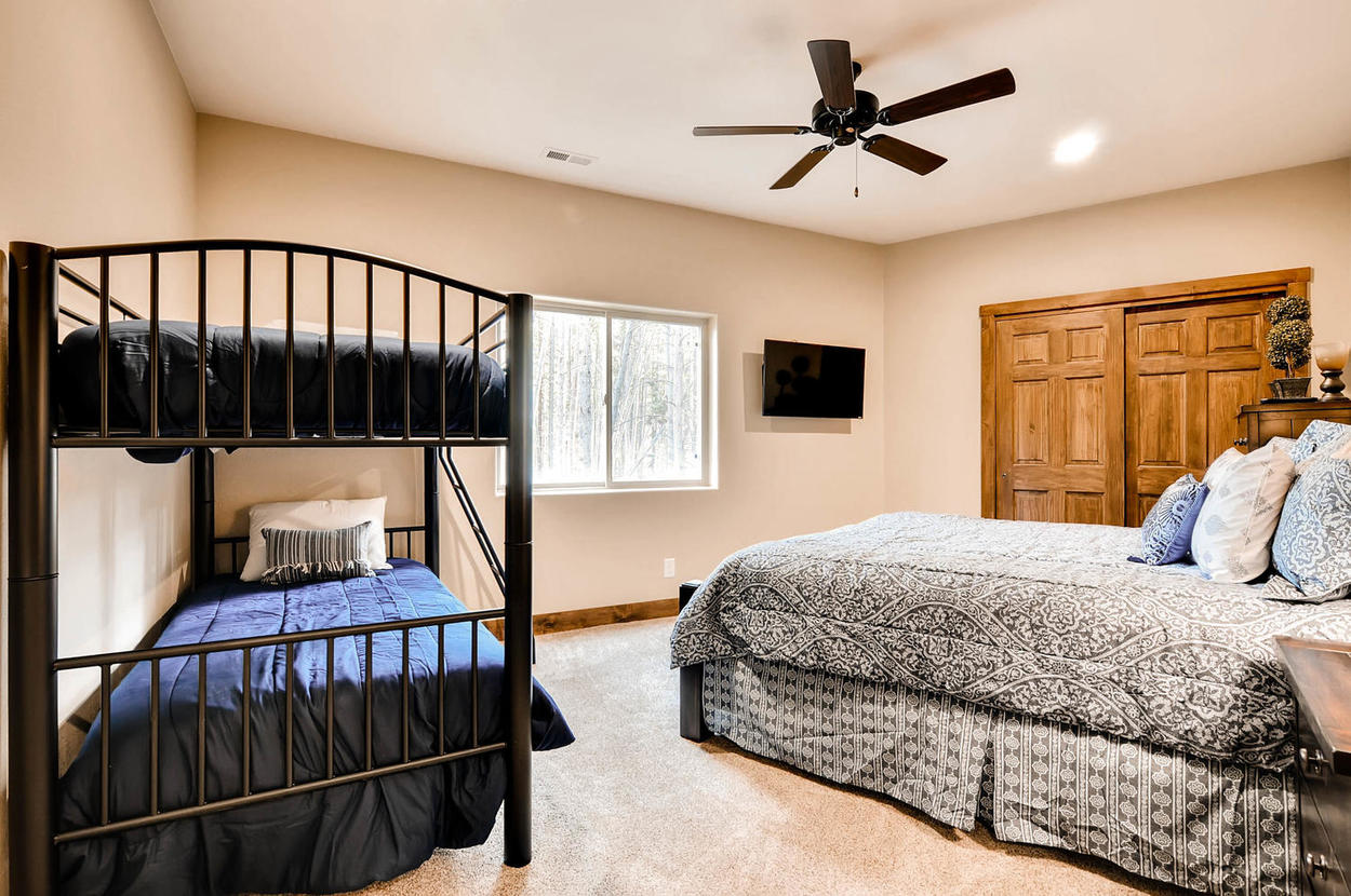 Great room for a family. Features a king bed, twin bunk bed, TV, and bathroom located directly across the hall.