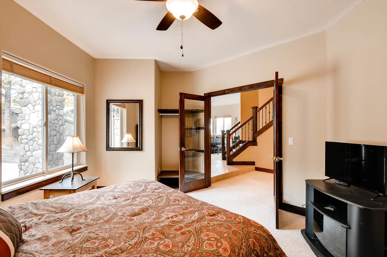 Located on the main floor, features a queen bed and TV.