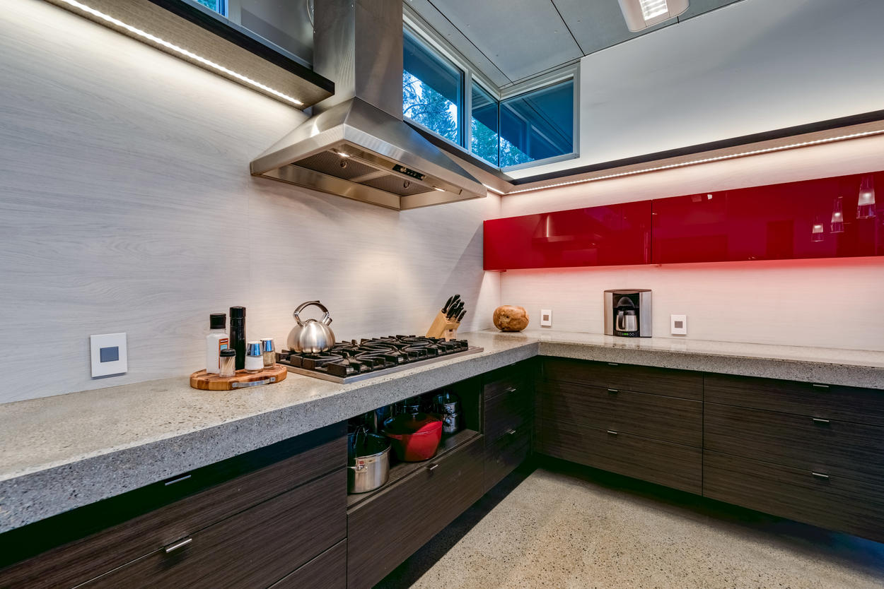On the main level of the home you'll find a gas range in the modern kitchen.