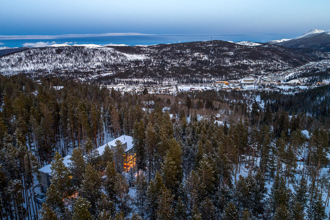 This 5,200-square-foot home is set on 2.5 acres that borders pristine National Forest land.