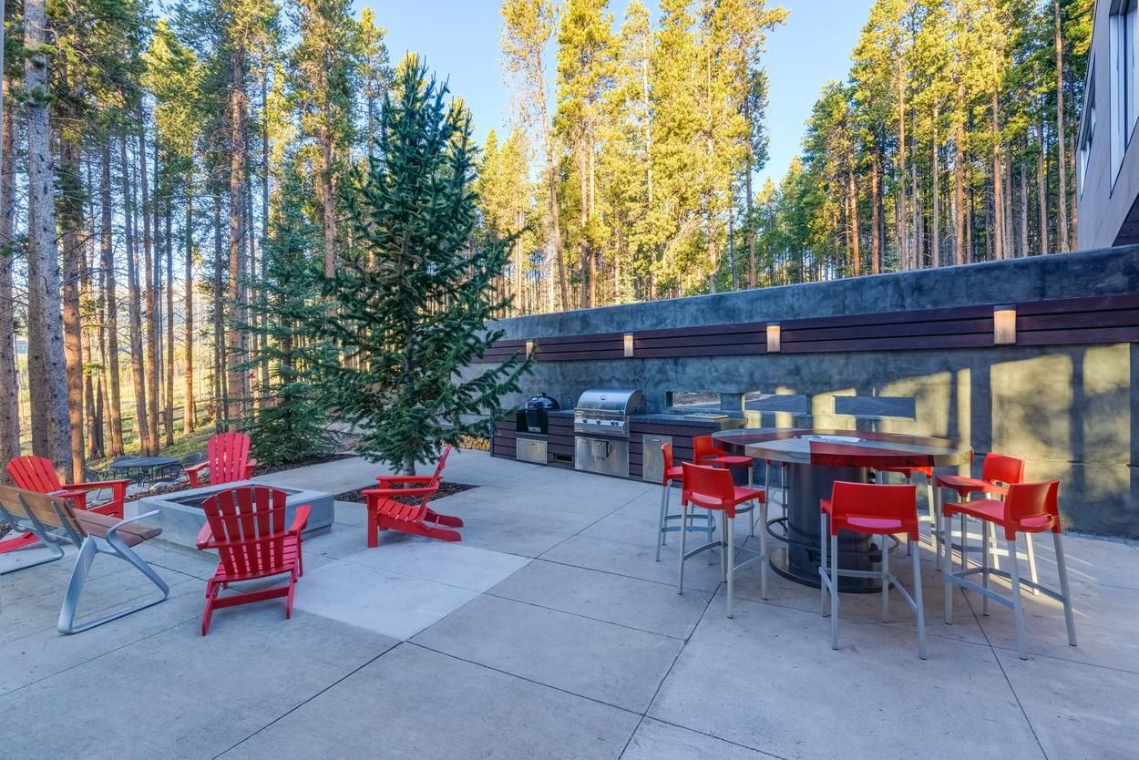 There's plenty of room for dining on the spacious summer patio, which features a giant gas grill, a ceramic egg smoker, and a large fire pit. Please note that this patio is maintained and available for summer use.