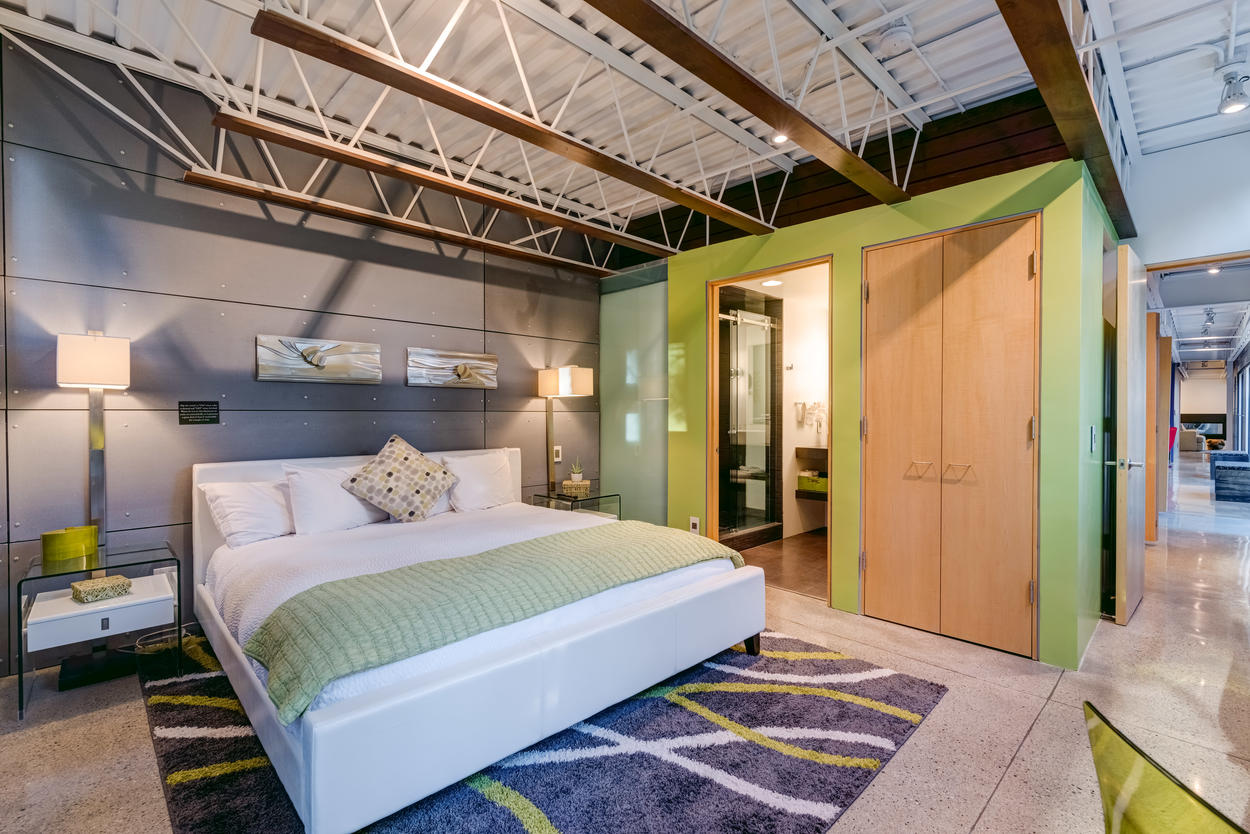 The Green bedroom on the upper level also has a king-size bed, comfy sitting area, large closet, and a convenient desk. Outdoor catwalk access through this room.