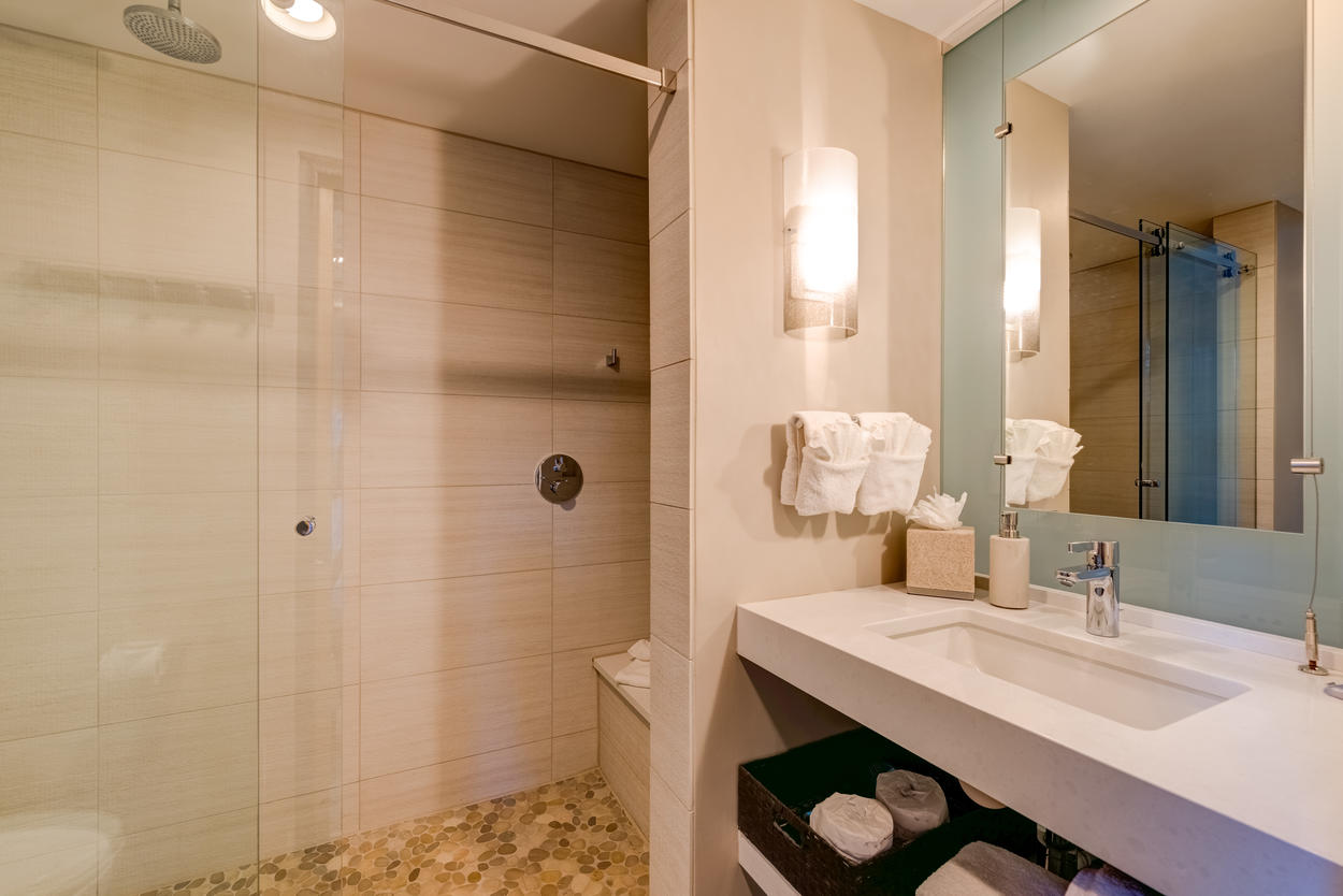 A spacious, walk-in shower awaits you off the Pebble room.
