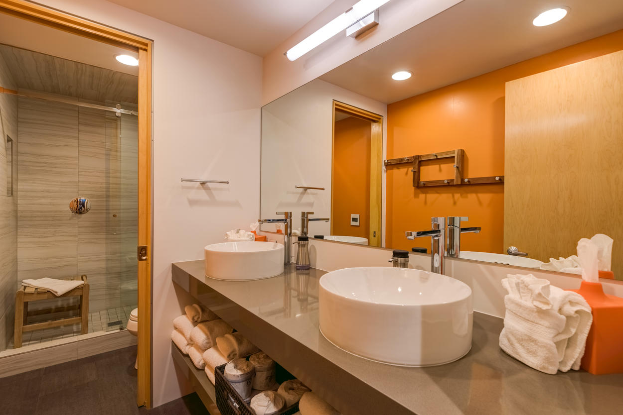 The lower level guest bathroom has dual sinks and a walk-in shower as well.