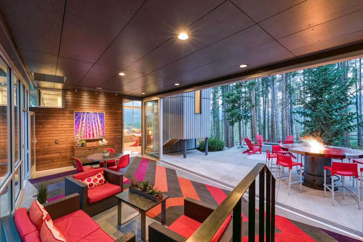 The breezeway seamlessly transitions to the outdoors, and opens up to the front summer patio, and back winter patio.