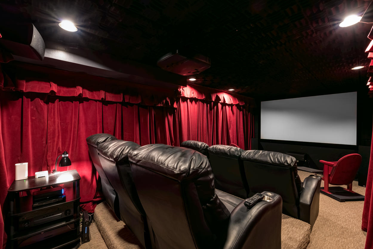 Sit back and relax in the home theater with an authentic projector and crystal-clear Sonos sound system.