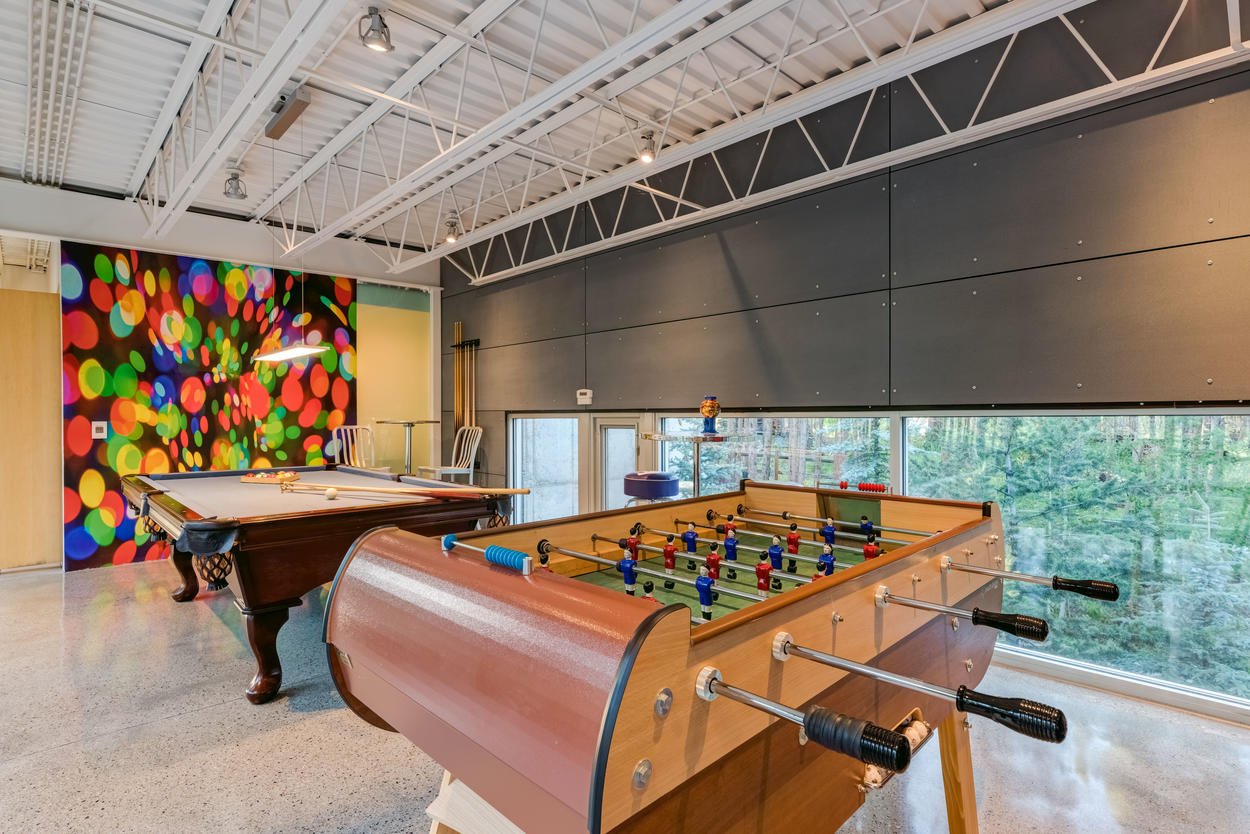There's plenty of fun to be had in the game room, which offers foosball, a pool table, and a bar complete with a Keurig, coffee bar, games, candy, Sonos music system, mini-fridge, microwave, and more.