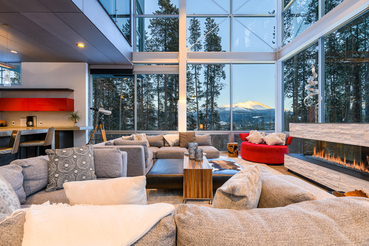 Walls of windows in the living area allow for plenty of natural lighting and gorgeous views