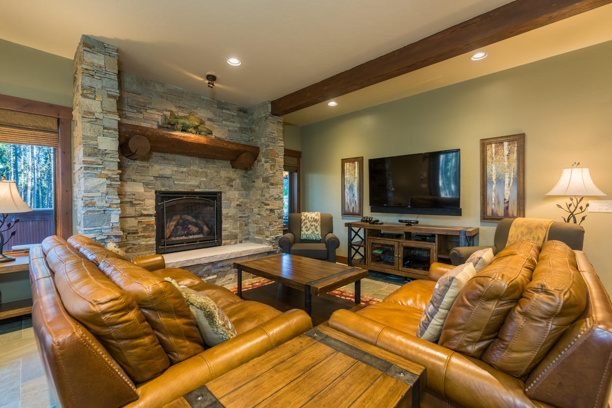 The lower level den also has a large fireplace, and just outside the doors, the hot tub is ready for use.