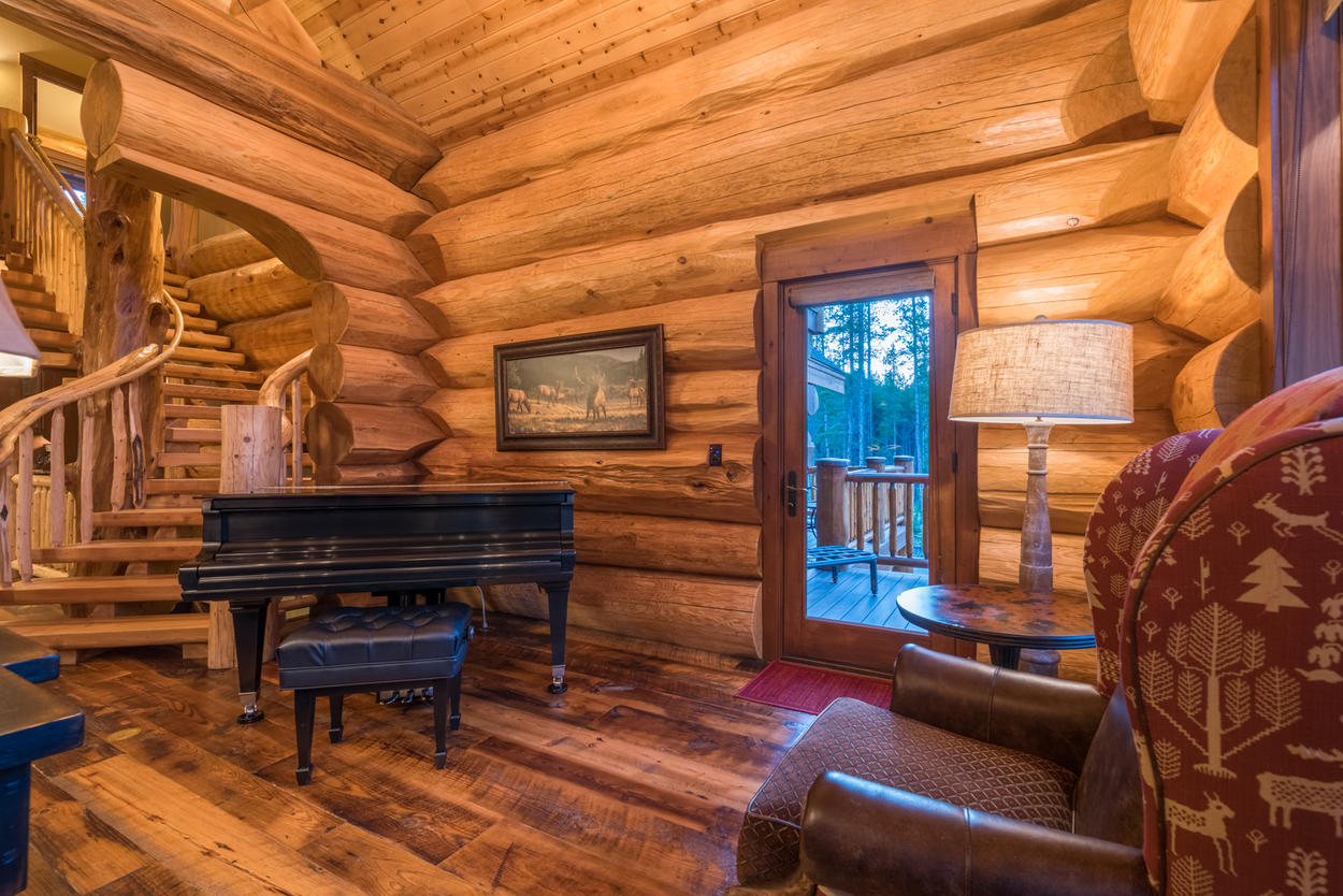 A grand piano in the corner adds an elegant touch, and is ready for playing.