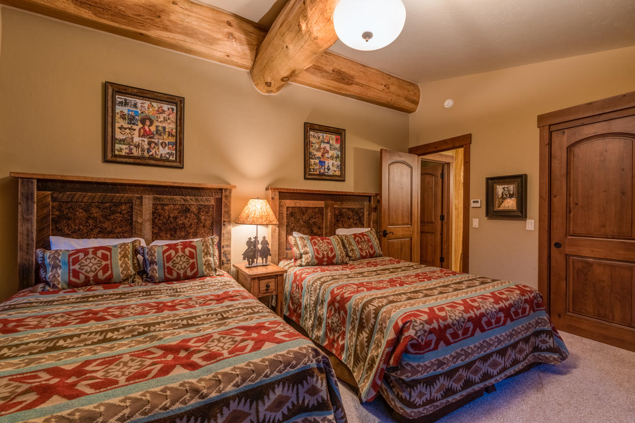 The upper level also houses the third guest bedroom, which has two queen-size beds.