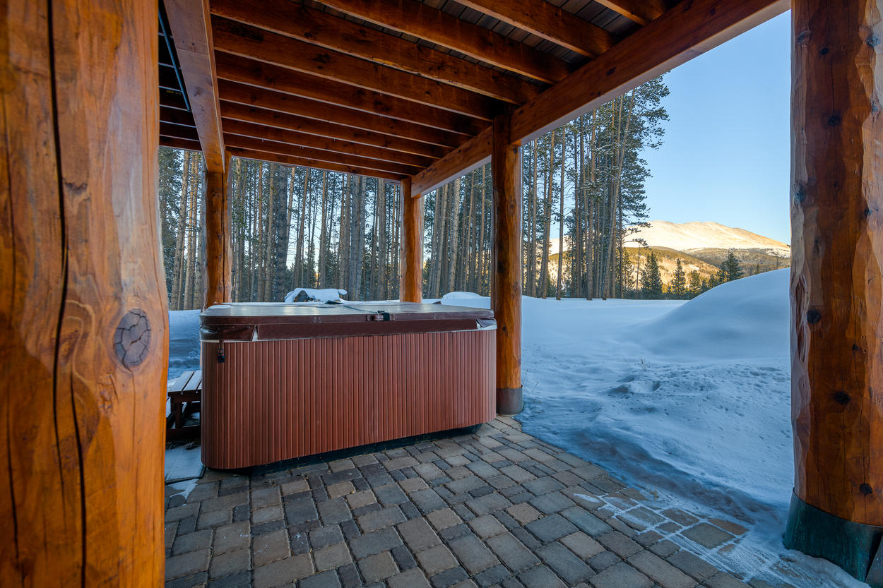 The private hot tub sits on the lower patio area just outside from the den.