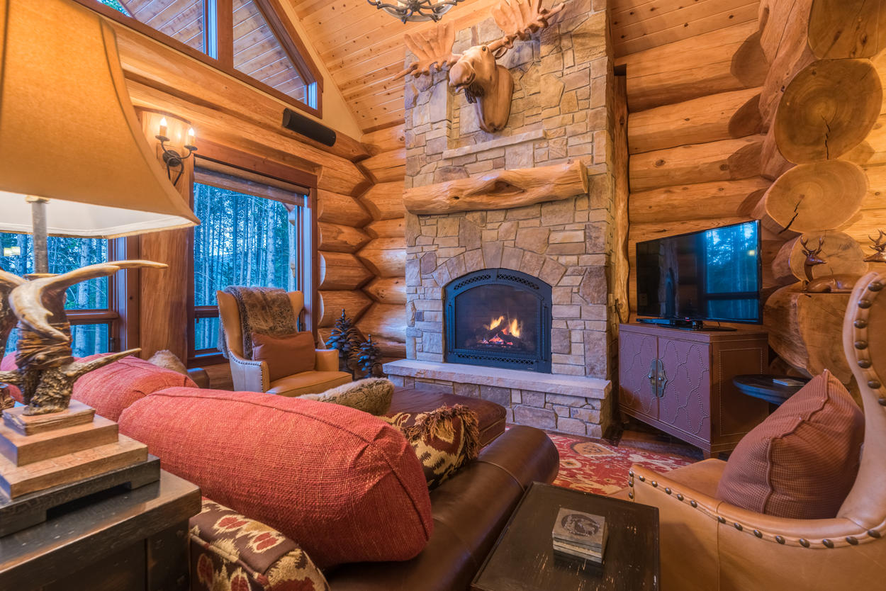 Leather chairs and couches surround the fireplace, creating an ideal space for gathering with family and friends.