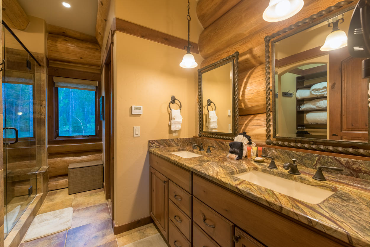 The attached Master ensuite has granite countertops, a double vanity, and a walk-in shower.