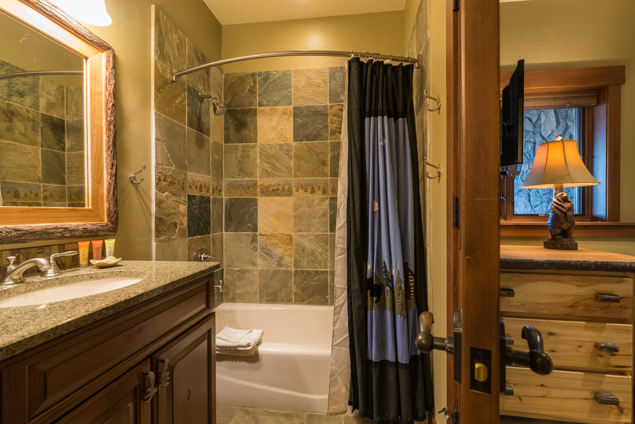 There's a large tub in the fourth bedroom's attached ensuite bathroom.