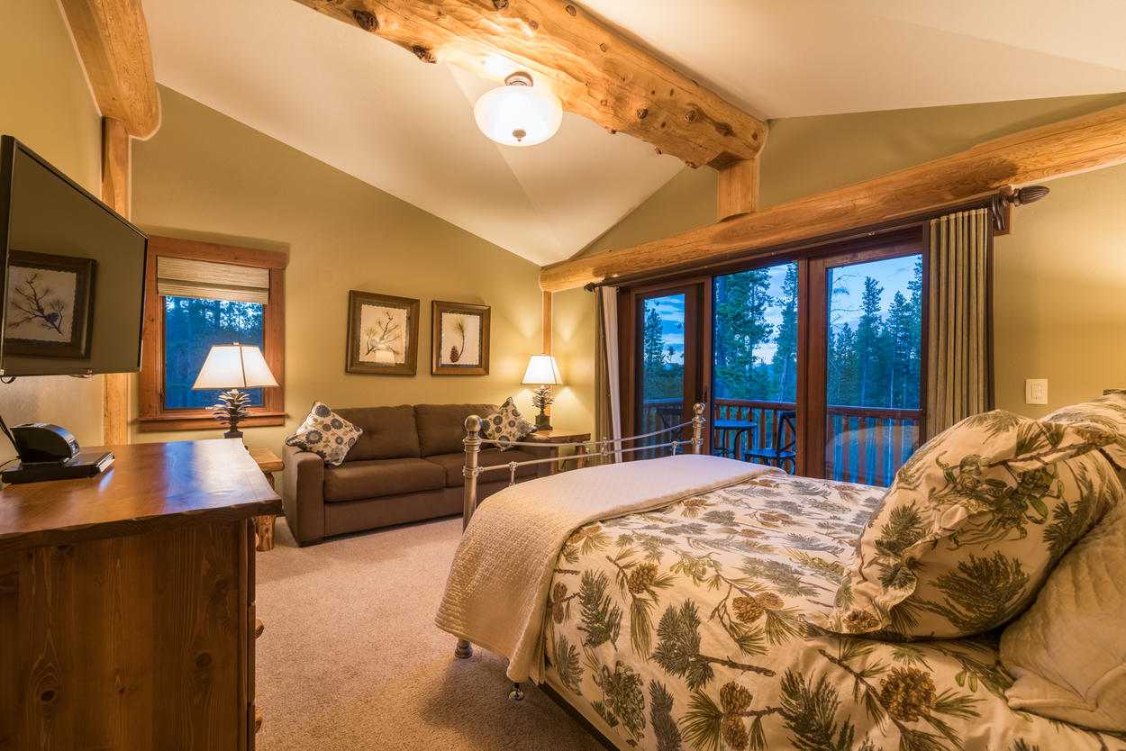 The second guest bedroom has its own balcony access as well as a sleeper sofa.