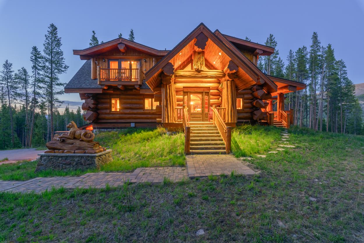 As night falls, Moose Ridge Cabin glows warm and bright.