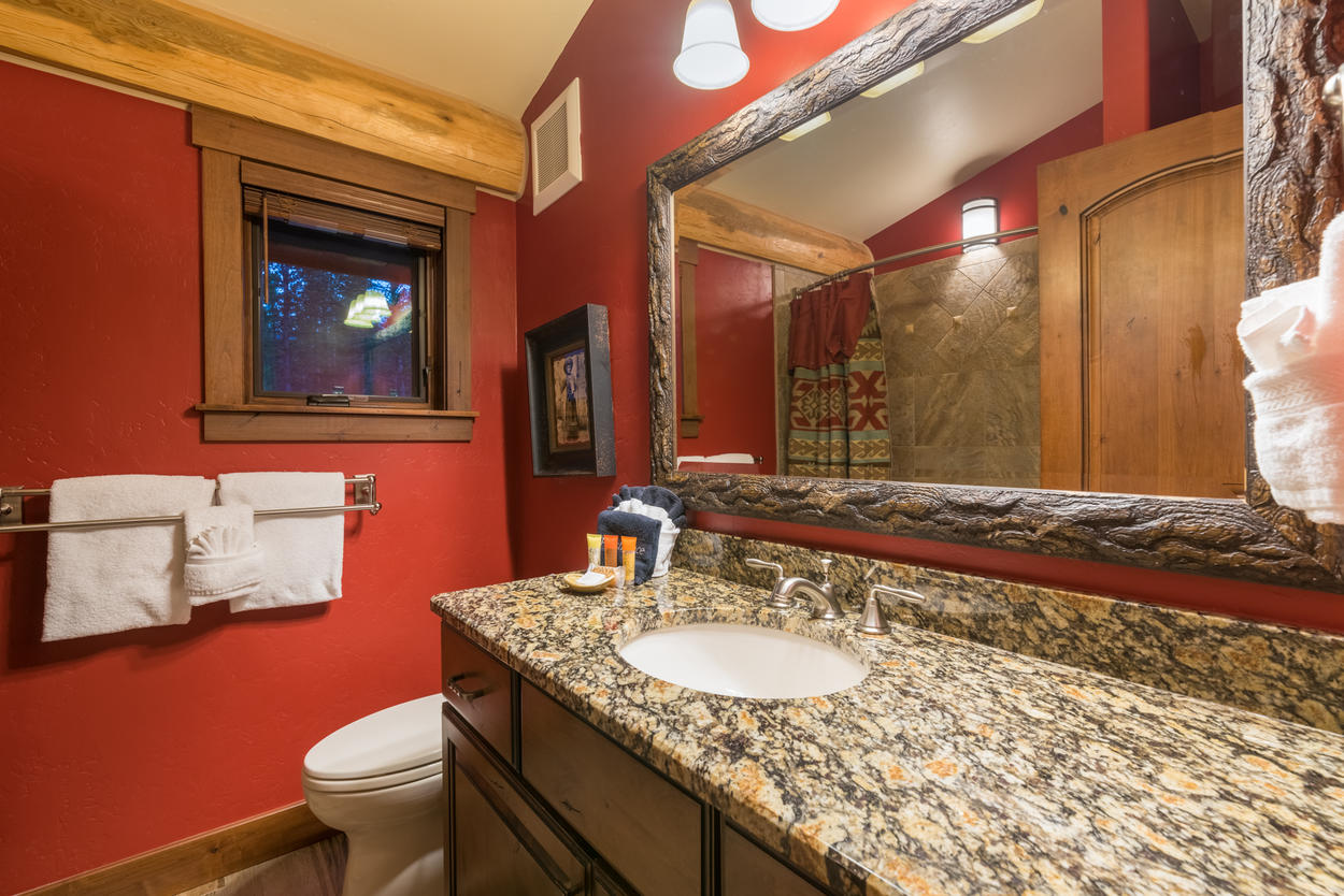 The shared guest bathroom has a shower/tub combination and a single sink.