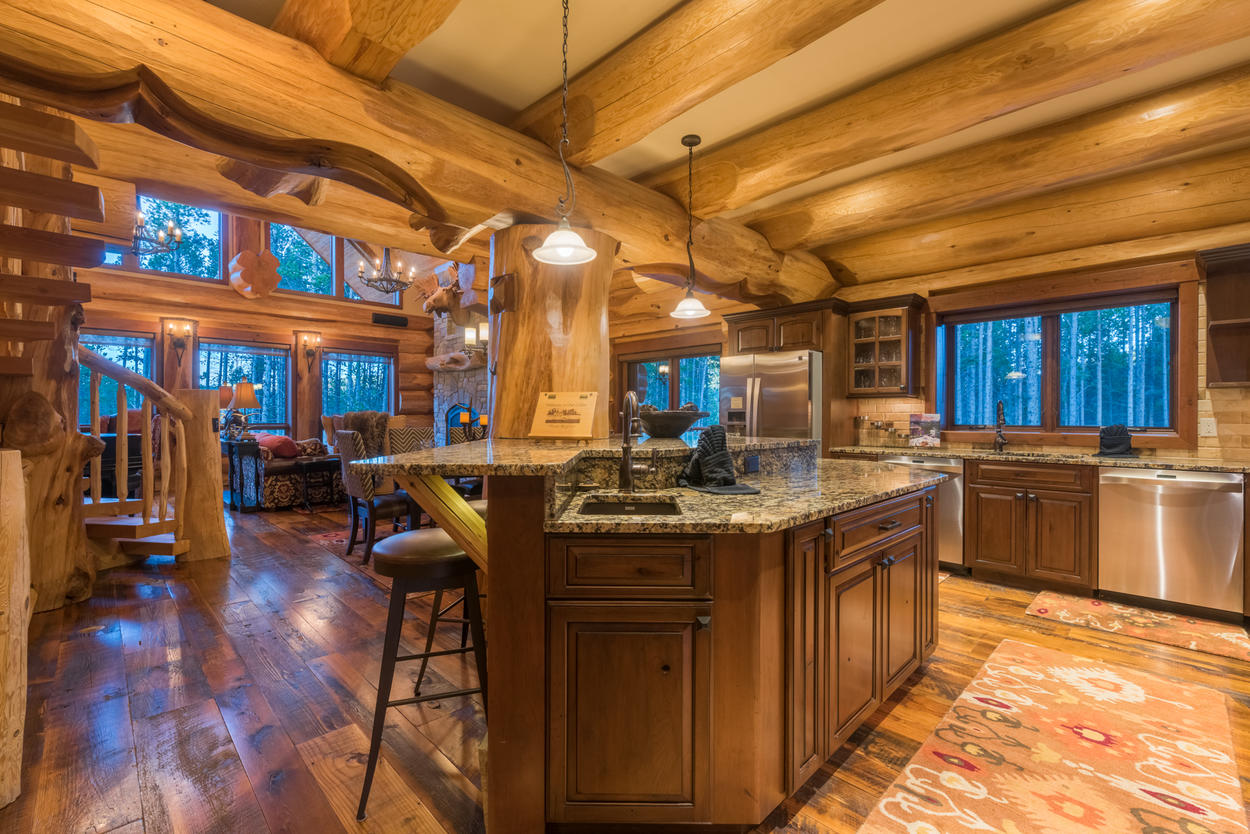 The kitchen island is also a breakfast bar that separates the area from the living and dining rooms.