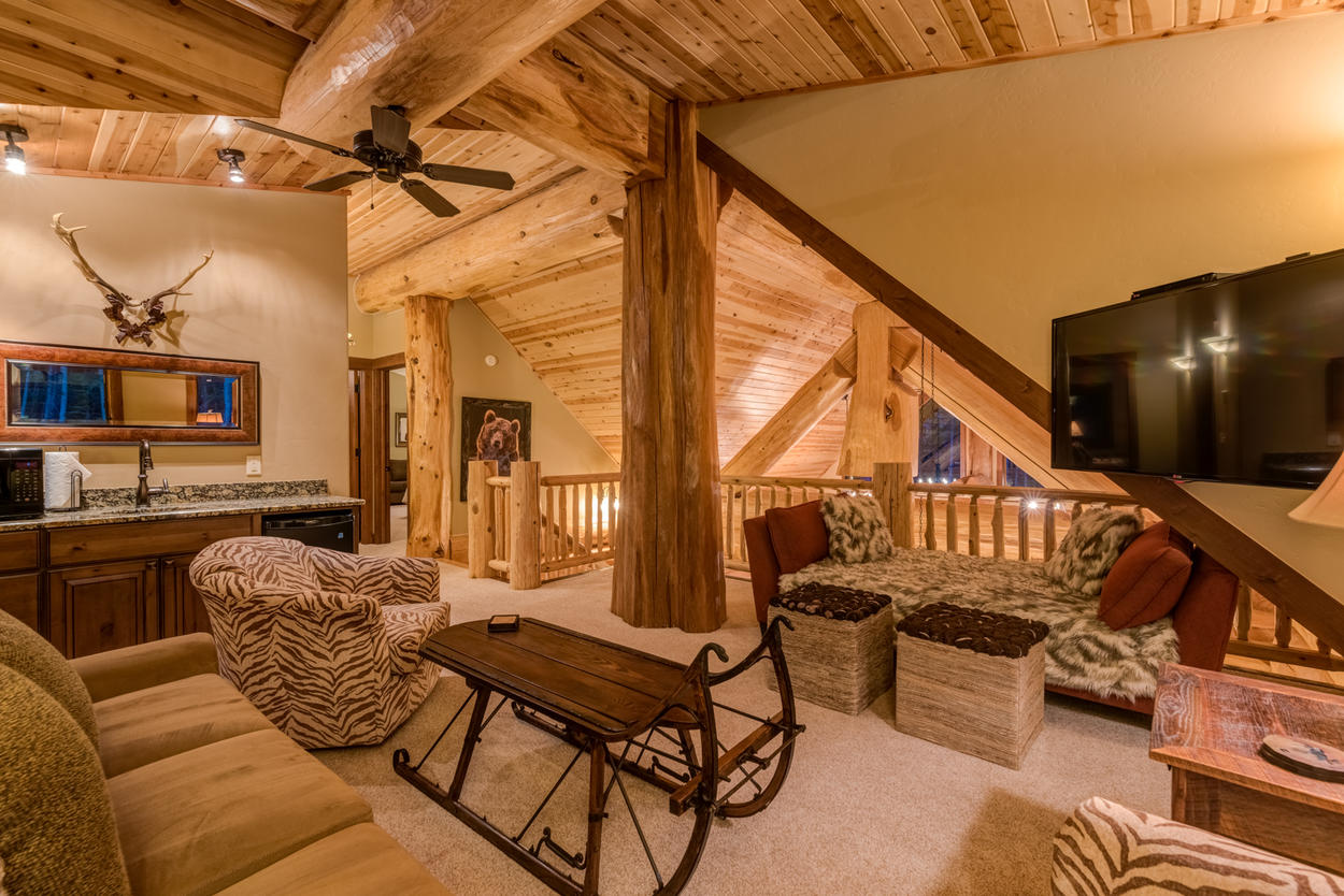 The upstairs loft area has a TV and a sleeper sofa.